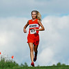 Richwood senior Madison Frame crests a hill on her last lap during a cross country invitational at the Pinecrest Industrial Park in Beckley on Tuesday. Frame finished first in the girls. (Chris Jackson/The Register-Herald)