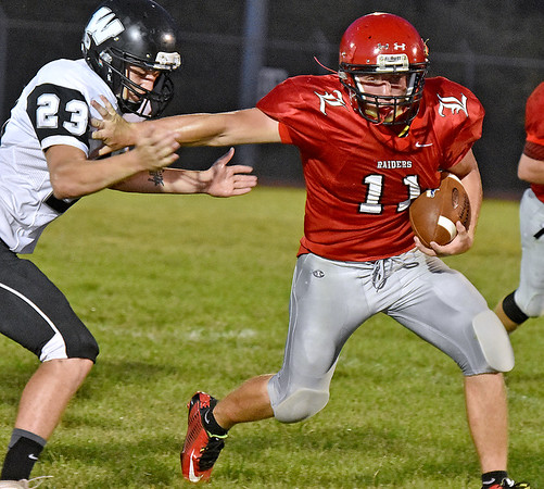 (Brad Davis/The Register-Herald) Liberty's Eric Workman rumbles forward as he stiff-arms Westside linebacker Dewayne Bledsoe Friday night in Glen Daniel.