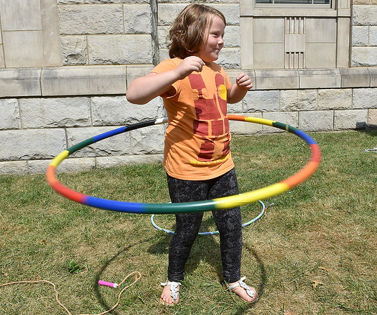 (Brad Davis/The Register-Herald) Nine-year-old Kaylin Marshall hula hoops during the Kids Classic Festival Saturday.