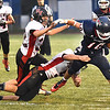 Connor Gibson, of Independence tries to break away from Pikeview defenders during game Friday night on George D Covey Field at Independence High School.<br /> (Rick Barbero/The Register-Herald)