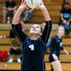 Meadow Bridge's Sheyla Harless (4) hits the ball up to a teammate during their match against Liberty in Oak Hill on Tuesday. (Chris Jackson/The Register-Herald)
