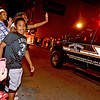 (Brad Davis/The Register-Herald) Trayveon Hairston, 12, Jenna Dyer (waving), 12, and Jayla Perry, 12, watch the Parade of Lights Sunday night in Beckley.