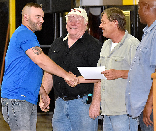 (Brad Davis/The Register-Herald) New River Career and Technical College graduate Ernest Ulbrich, left, is congratulated by faculty members as he accepts his certificate during a commencement ceremony at the school's Advanced Technology Center in Ghent Wednesday afternoon.