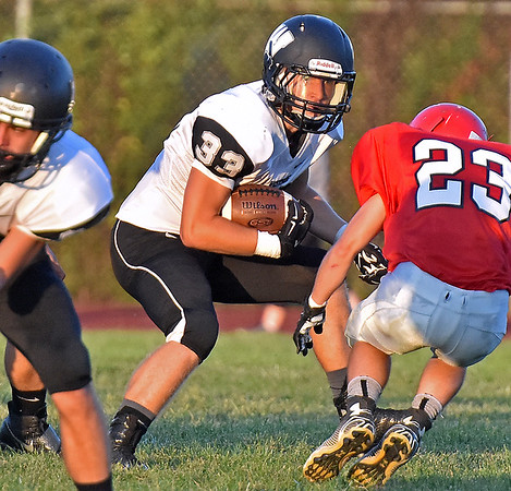 (Brad Davis/The Register-Herald) Westside's Brock Smith carries the ball against Liberty Friday night in Glen Daniel.