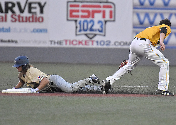 (Brad Davis/The Register-Herald) Quicy's Houston Looser steals second base for a second time during game one of the Prospect League championship series against the West Virginia Miners Thursday night at Linda K. Epling Stadium in Beckley.