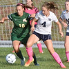 (Brad Davis/The Register-Herald) Shady Spring's #4 battles for possession with Greenbrier East's Abbie Bartenslager during the Tigers' game against the Spartans Thursday night at the YMCA Paul Cline Memorial Sports Complex.
