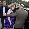 (Brad Davis/The Register-Herald) Limo driver Richard Jarrell holds the door as Julia Rourer and escort Willis Boyko enter during an Enchanted Prom event Friday night inside The Place at United Methodist Temple. The event, sponsored by Chick-fil-A, provided carriage rides, a spin in a limousine, red carpet-style photo ops and a lavish prom-style dance event for people of all ages with special needs.