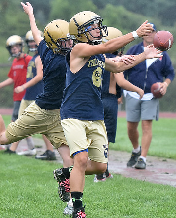 (Brad Davis/The Register-Herald) Shady Spring players Dylan O'Dell, right, and Bryce Hodges battle for the ball while running receiving drills during Tigers football practice Wednesday afternoon.