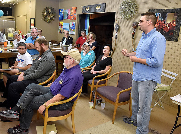 (Brad Davis/The Register-Herald) Area resident Matt Detch, far right, voices his concerns prior to a live YouTube event featuring former presidential candidate Bernie Sanders from Burlington, Vermont Wednesday night at 110 Marshall.