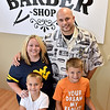 (Brad Davis/The Register-Herald) Owner Dusty Cochran, his wife Tisha and sons Gavin, right, and Maddox at his newly opened barber shop in Crab Orchard Friday evening.