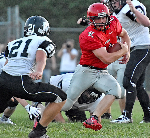 (Brad Davis/The Register-Herald) Liberty's Eric Workman rumbles forward Friday night in Glen Daniel.