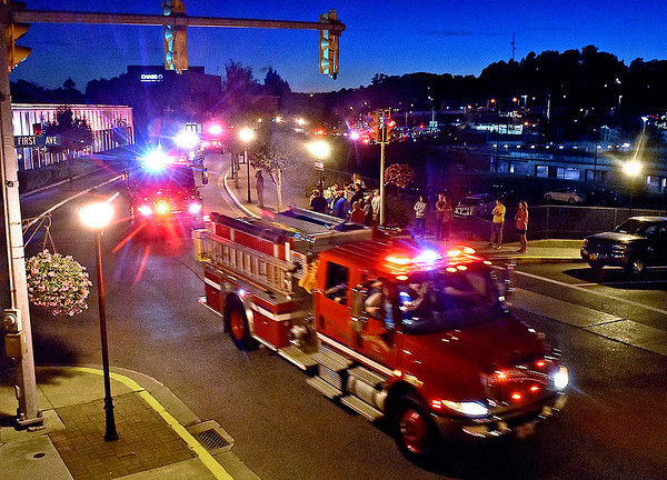 (Brad Davis/The Register-Herald) A caravan of police, fire, EMS and first response vehicles from departments all over the area make their way up Neville Street during the annual Parade of Lights Sunday night.