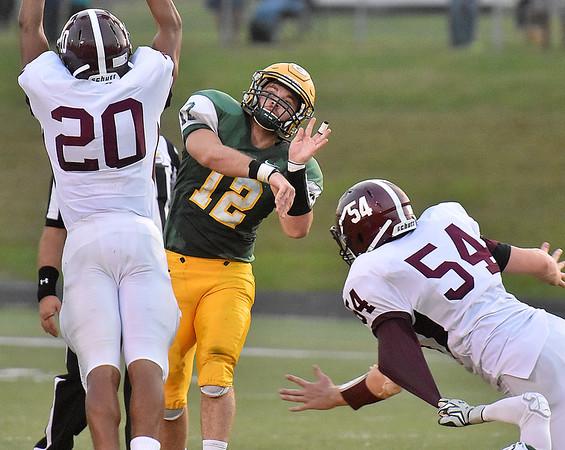 (Brad Davis/The Register-Herald) Greenbrier East quarterback Devin Persinger throws Friday night in Fairlea.