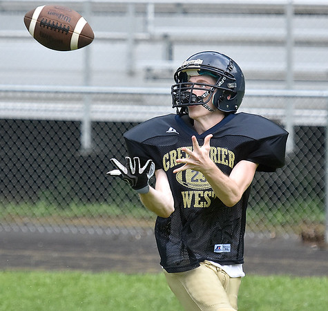 (Brad Davis/The Register-Herald) Cavaliers receiver Cody Femster hauls in a pass during practice Friday afternoon at Greenbrier West High School in Charmco.