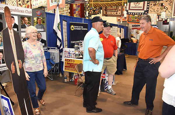 Senator Joe Manchin, right, talks with Sue McKinney, left, senator Kent Leonhardt and Doug McKinney, of Lewisburg at the West Virginia State Fair in Fairlea.<br /> (Rick Barbero/The Register-Herald)