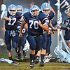 (Brad Davis/The Register-Herald) Meadow Bridge storms onto the field prior to their game against Midland Trail Friday night.