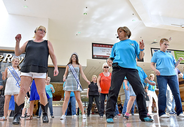 (Brad Davis/The Register-Herald) Instructor Lotus Bailes, front row right, leads a group in the Crossroads Mall Saturday afternoon as she teaches them how to line dance as part of the Appalachian Festival. She teaches line dancing at the Moose Lodge on New River Drive every Friday from 7:00-9:00 p.m. and you don't have to be Moose member to join in the fun.