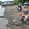 (Brad Davis/The Register-Herald) Six-year-old Christopher Wriston, right, keeps a sharp eye on his bobber as he, eight-year-old brother Phillip, left, and father Charles spend a day fishing on Bluestone Lake Sunday afternoon near Hinton.