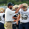 Shady Spring head coach Vince Cullicerto bops Gavin Turman on the helmet during warm-ups prior to their game against Nicholas County in Summersville on Friday. (Chris Jackson/The Register-Herald)