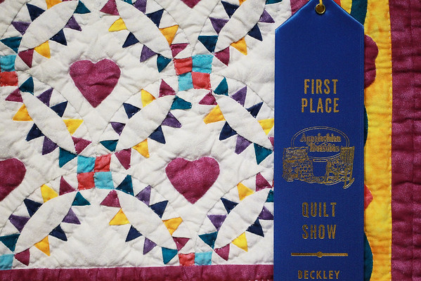 "Betty Erskine, from Jumpin Branch, won first place for her ""Little Big Hearts"" quilt during the annual quilt show as part of the Appalachian Arts and Craft Fair at the Beckley Raleigh County Convention Center on Friday. (Chris Jackson/The Register-Herald)"