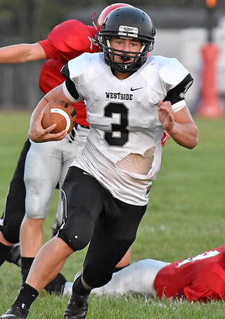 (Brad Davis/The Register-Herald) Westside's Josh Morgan carries the ball Friday night in Glen Daniel.