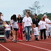 Joanna Thomas, third from left, mother of Jonathan Thomas, leads the group for the Jonathan Thomas Memorial Fun Walk Friday at Woodrow Wilson High School on Friday. Jonathan was killed on the job last year. (Chris Jackson/The Register-Herald)