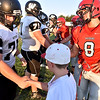 (Brad Davis/The Register-Herald) Coin toss and handshake prior to Westside at Liberty Friday night in Glen Daniel.