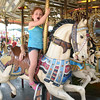 Abigail Jarvis, 4, daughter of Chris and Stephanie Jarvis, of Bastian, Va, rides the Merry-Go-Round at the West Virginia State Fair in Fairlea.<br /> (Rick Barbero/The Register-Herald)