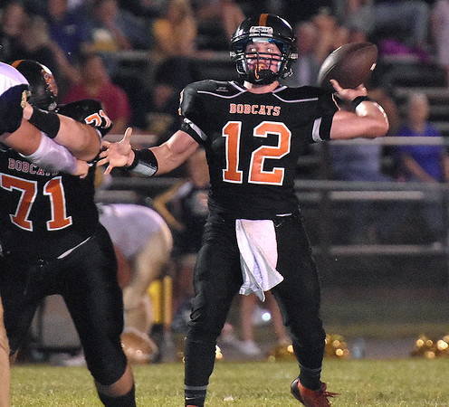 (Brad Davis/The Register-Herald) Summers County's Nathan Grimmett throws against Shady Spring Friday night in Hinton.