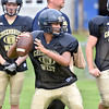 (Brad Davis/The Register-Herald) Cavaliers quarterback Malyk Cox works through passing drills during practice Friday afternoon at Greenbrier West High School in Charmco.
