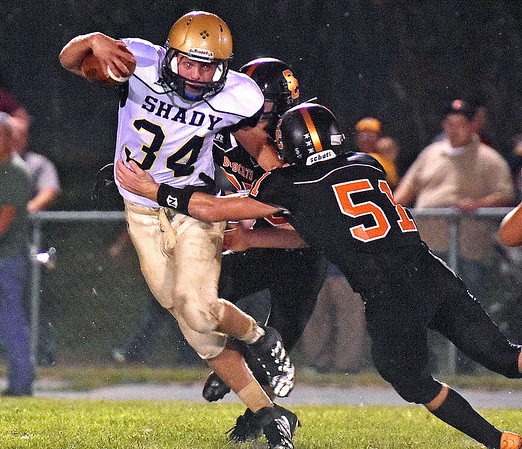 (Brad Davis/The Register-Herald) Shady Spring's Keith Sexton tries to dodge a pair of Summers County defenders as he carries the ball Friday night in Hinton.