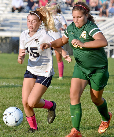 (Brad Davis/The Register-Herald) Shady Spring's #15 races for a loose ball with Greenbrier East's Megan Hofmann during the Tigers' game against the Spartans Thursday night at the YMCA Paul Cline Memorial Sports Complex.