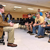 (Brad Davis/The Register-Herald) Keith McIntosh (left), state projects coordinator for Senator Joe Manchin, speaks with New River Career and Technical College graduates (from right) Mark Hunt, Calvin Lester and Aaron Killen, among others, about what the future holds for them and the state prior to their commencement ceremony at the school's Advanced Technology Center in Ghent Wednesday afternoon.