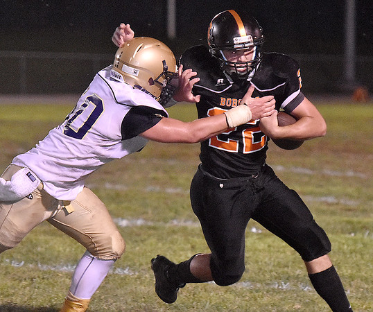 (Brad Davis/The Register-Herald) Summers County running back Dillon Smith carries the ball as Shady Spring's Dylan McCall tries to bring him down Friday night in Hinton.