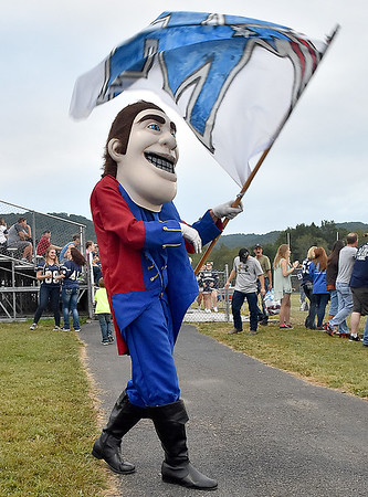 (Brad Davis/The Register-Herald) Midland Trail's Patriot mascot twirls the school flag as he meanders through the the Meadow Bridge side of the field Friday night.
