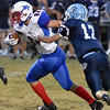 (Brad Davis/The Register-Herald) Midland Trail receiver Moah Minor tries to shake a tackle from Meadow Bridge's Will Woods after making a catch Friday night.