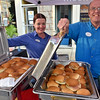 (Brad Davis/The Register-Herald) Tamarack food court employees April Cox and Joey Cozart proudly show off full pans of a true appalachian classic, fried green tomato sandwiches, during Taste of Beckley Saturday evening.