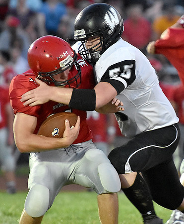 (Brad Davis/The Register-Herald) Westside linebacker Ben Price, right, stuffs Liberty running back Eric Workman in the backfield during the Renegades' season-opening win over the Raiders Friday night in Glen Daniel.