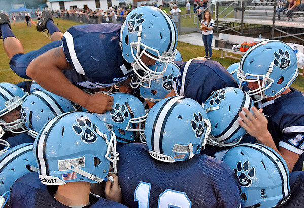 (Brad Davis/The Register-Herald) Meadow Bridge players get fired up for their game against Midland Trail Friday night.