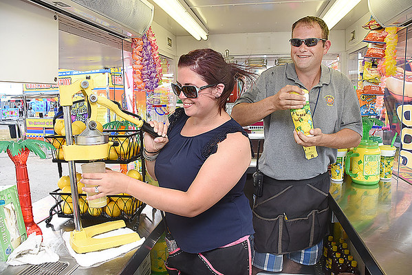 Justin and Avery Vonderheid making lemonade in the Vons Lemonade stand at the West Virginia State Fair in Fairlea.<br /> (Rick Barbero/The Register-Herald)