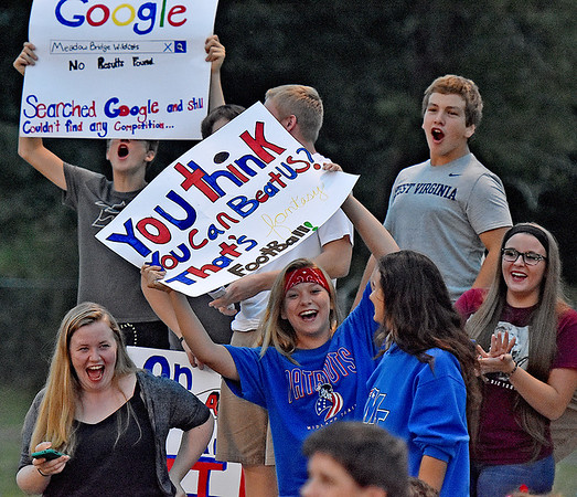 (Brad Davis/The Register-Herald) Rowdy Midland Trail students make sure their presence is felt Friday night in Meadow Bridge.