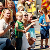 Parens with their children watch as the annual Pineville Labor Day Parade  moves through town on Monday. (Chris Jackson/The Register-Herald)
