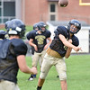 (Brad Davis/The Register-Herald) Cavaliers quarterback Hunter Bevins works through passing drills during practice Friday afternoon at Greenbrier West High School in Charmco.