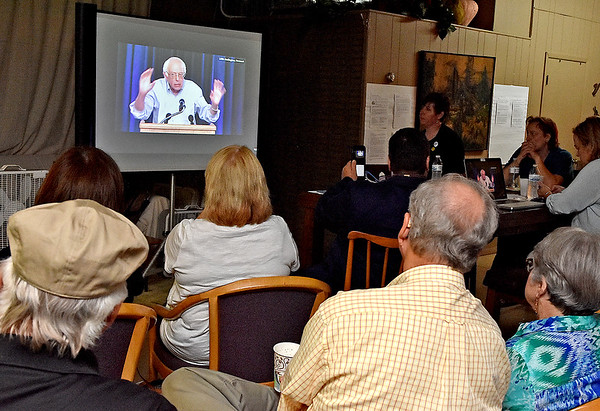 (Brad Davis/The Register-Herald) Area residents watch live on YouTube as former presidential candidate Bernie Sanders delivers a speech from Burlington, Vermont Wednesday night at 110 Marshall.