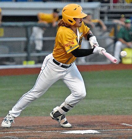 (Brad Davis/The Register-Herald) West Virginia's Nick Delgado suprises the Gems defense with well executed bunt during the Miners' win over the Quincy Gems in game one of the Prospect League championship series Thurday night at Linda K. Epling Stadium.