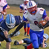 (Brad Davis/The Register-Herald) Midland Trail running back Tomas Ferris breaks a would-be tackle from Meadow Bridge's Will Woods as he rumbles through the Wildcats defense Friday night.