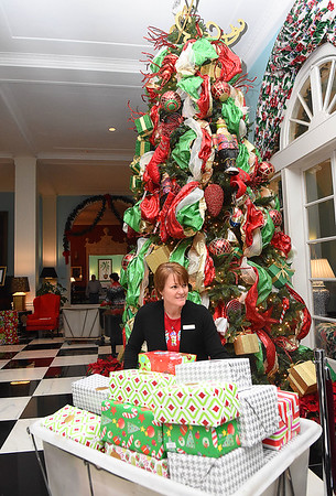 Lynn Tuckwiller, employee for The Greenbrier Resort, carts away Christmas gifts for the Dream Tree Children distribution.<br /> (Rick Barbero/The Register-Herald)