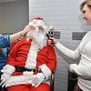 (Brad Davis/The Register-Herald) Santa Claus takes the opportunity for a beard trim from Kilted Barber stylist Kayla Pysz inside the Kirkpatrick building during the first ever Small Business Saturday shopping event yesterday in Uptown Beckley.
