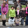 (Brad Davis/The Register-Herald) Kids wait for the candy to start flying during Fayetteville's Christmas Parade Saturday evening.