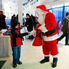 Khonner Keffer, 6, from Daniels, gets candy from Santa Claus during the Mac's Toy Fund at the Beckley-Raleigh County Convention Center on Saturday. (Chris Jackson/The Register-Herald)